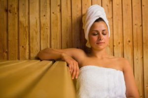 Calm woman relaxing in a sauna